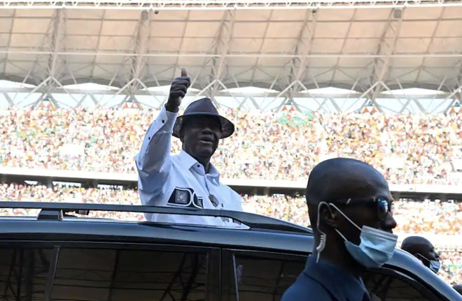Ivorian President Alassane Ouattara gives a thumbs up to supporters Oct. 3 during the inauguration of the country's new Olympic Stadium in Ebimpe. (Issouf Sanogo/AFP/Getty Images)