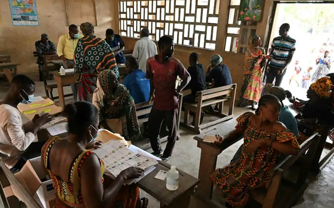 Residents line up to receive their voting cards in Abidjan, Ivory Coast, on Oct. 14. (Issouf Sanogo/AFP/Getty Images)