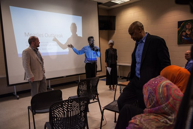 Abdirizak Bihi translates for Ilhan Omar at her event in Brian Coyle Community Center in Minneapolis on May 17, 2017.