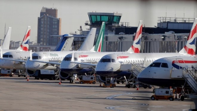 Airplanes are parked at London City Airport, where flights were canceled Monday after an unexploded World War II bomb was found nearby. (Frank Augstein/AP)