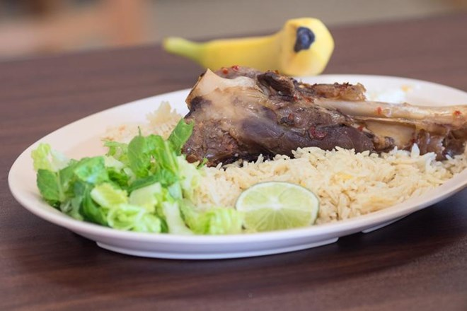 A lamb on rice dish with salad and a banana made at Brothers Restaurant and Grocery. Photo by Jackson Forderer