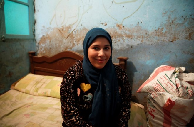 Esraa Salah, 15, looks on at her home in Alwasata village of Assiut Governorate, south of Cairo, Egypt, February 8, 2018. Picture taken February 8, 2018. REUTERS/Hayam Adel