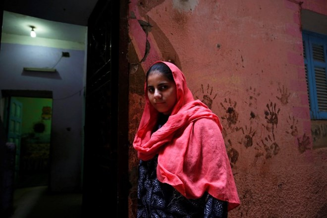Nada Salah, 14, looks on outside her home in Alwasata village of Assiut Governorate, south of Cairo, Egypt, February 8, 2018. Picture taken February 8, 2018. REUTERS/Hayam Adel