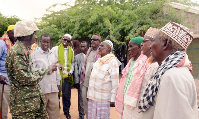 Col. Bonny Bamwiseki chatting with chiefs and elders at Ceerjaale in Somalia. PHOTOS: Eddie Ssejjoba
