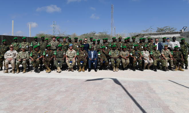 Senior officers from the African Union Mission in Somalia (AMISOM) and other international partners pose for a group photograph after the opening session of the AMISOM Sector Commanders' Conference to discuss and review the Concept of Operations in Mogadishu, Somalia, on 11 February 2019. AMISOM Photo / Omar Abdisalan